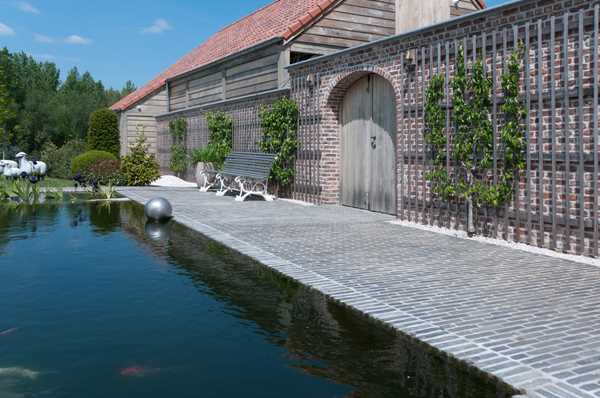 Holiday in your own garden with a hint of exclusivity thanks to sustainable 'Oyster grey' clay pavers
