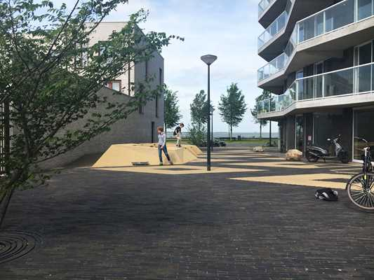 Contrasting pattern of SeptimA clay pavers bring colour to Kieke-Boe district square in Amsterdam